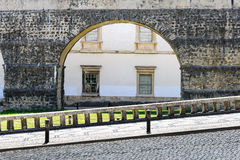 Paved road with aqueduct in background, Coimbra (Portugal). Paved road with arch of the aqueduct in background, Coimbra (Portugal Stock Photos