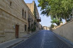 Paved road around houses of Baku old city. Paved road near houses and wall of old city Baku stock photography
