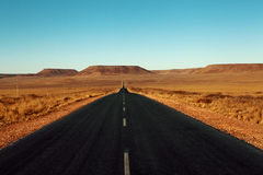 Paved road in the desert Stock Image