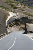 Paved road through deserted volcanic landscape on Tenerife, Spain Stock Photo