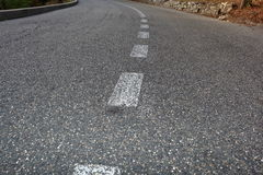 Paved road with dividing line. Focus on foreground Royalty Free Stock Image