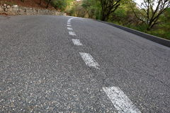 Paved road with dividing line. Focus on foreground Stock Photo