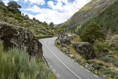 Paved road through the glacier valley next to Manteigas. Town, Guarda district, Portugal stock images