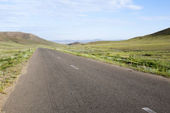 Paved Road through Mongolian Steppes Stock Photo