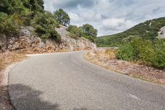 Paved road between the mountains Stock Photo