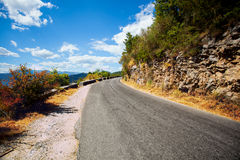 Paved road in the mountains far away Stock Photos