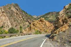 Paved Road Through the Mountains Royalty Free Stock Photos