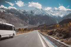 Paved road with a view of snow capped mountain range, Karakoram highway. Pakistan. Paved road in Passu with a view of snow capped mountain range, Karakoram stock image