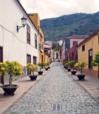 Paved road with pots. View of a paved road in the Spanish town of Garachico, you see the mountains in the background Royalty Free Stock Image