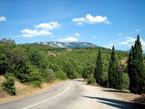 Paved road with sharp turns in the picturesque foothills in the South on a clear day. Asphalt road with sharp turns in the picturesque foothills in the South on royalty free stock images