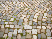 Paved road to monastery Stock Images