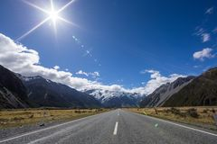 Sun flare on the road to Mt Cook Village, New Zealand Stock Images