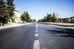 Road to nowhere. Paved road to nowhere traversed boring day in the hot summer Royalty Free Stock Image