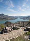 Paved road  of zahara. Lake located in the town of Zahara de la Sierra in the Spanish province of Cadiz, is the coast and mountain scenery in the background Stock Images