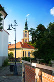 A paved street and a church in the center of Szentendre, a little touristic town near Budapest. Hungary stock image