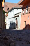 Paved street with old houses in Sighisoara Royalty Free Stock Photography