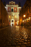 Paved street and parish church Royalty Free Stock Photography