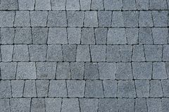 Paved track of gray trapezoidal brick. Paved trail of gray trapezoidal brick of different sizes Royalty Free Stock Images
