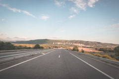 Paved two lane road crossing mountains and forest. Panoramic view from car mounted camera. Summer adventure and roadtrip in the Fr Stock Images