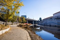 Paved walking path following the shoreline of Guadalupe river cl. Ose to the downtown area, San Jose, south San Francisco bay area, California stock photos