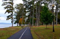 Paved walking trail thru park Stock Photo