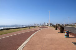 Paved Walkway with Hotels in Distance on Durban's Golden Mile Stock Image
