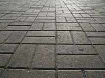 Pavement. The road surface of concrete blocks Stock Image
