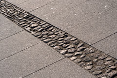 Pavement. Stone pavement of a town reflecting the light of the setting sun Stock Images