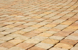 Pavement. Close-up of new old-style pavement of stoneblocks (bricks) of warm color Stock Photos