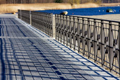 Pavement. Sidewalk along the lake with railing Royalty Free Stock Photos