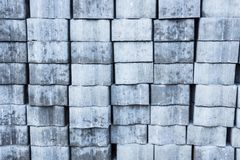 The pavement block brickwork prepared for workingbackground texture. New blocks for sidewalk are stacked in the brickwork and prepared for working Royalty Free Stock Photos