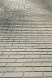 Pavement bricks. Pavement grey concrete bricks texture Royalty Free Stock Image