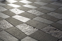 Pavement built of white and black stone slabs Royalty Free Stock Photography