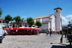 Pavement cafe and church, Granada. Royalty Free Stock Photos