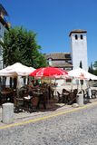 Pavement cafe and church, Granada. Stock Image