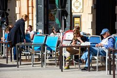Pavement cafe, Mosta, Malta. Tourists relaxing at a pavement cafe in the town centre, Mosta, Malta, Europe Royalty Free Stock Image