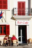 Pavement cafe, Naxxar, Malta. Group of people relaxing at the Red Cafe in the Pjazza Vittorja, Naxxar, Malta, Europe Stock Photos