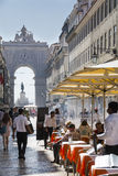 Pavement Cafe in Rua Augusta Lisbon. Pavement cafes and shops in Rua Augusta, downtown Lisbon Royalty Free Stock Image