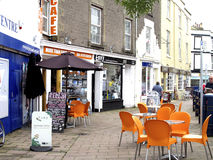 Pavement Cafe, Teignmouth, Devon. Cafe with alfresco pavement seating in the town at Teignmouth, South Devon,England, UK Stock Photography