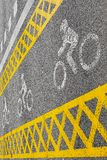 A yellow bike path crosses the road. royalty free stock images