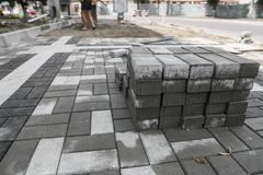 Pavement cobblestone in the stack on the street. Concrete or granite gray square pavement slabs for sidewalk. Construction. Industry manufacturing or building royalty free stock photos