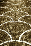 Pavement with cobblestones, sepia hue Royalty Free Stock Image