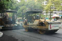 Pavement construction large machine equipment in China ,Asia. The workers are carrying out road construction using large machine equipment in China ,Asia Royalty Free Stock Photo
