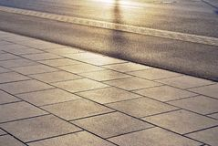 Pavement. In construction is an outdoor floor or superficial surface covering. Paving materials include asphalt, concrete, stone such as flagstone, cobblestone stock image
