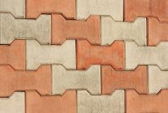 Pavement detail. Orange and gray sidewalk pavement detail Stock Photography