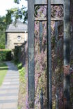 A pavement and the gate in Glasgow's Pollok Country Park Royalty Free Stock Images