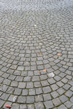 Pavement of granite with fish scale pattern Stock Photography