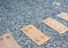 Pavement in the gravel garden Royalty Free Stock Image