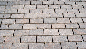 Pavement of gray cobblestones closeup Royalty Free Stock Photo