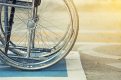 Pavement handicap symbol and wheelchair in the hospital. Medicine and healthy concept Royalty Free Stock Image